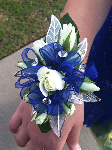 Corsage Blue Silver blue and silver wrist corsage festive prom flowers