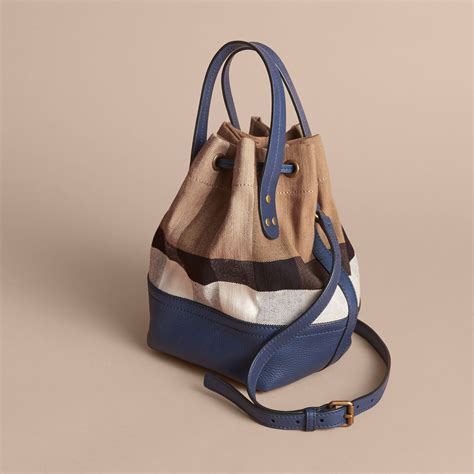 check in bag united small canvas check and leather bucket bag in brilliant
