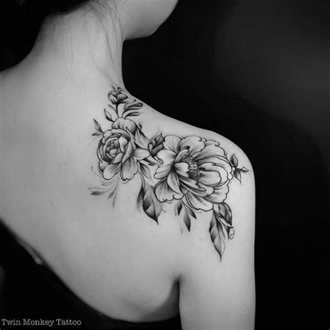 small black and white flower tattoos black and white peony flowers on right back shoulder