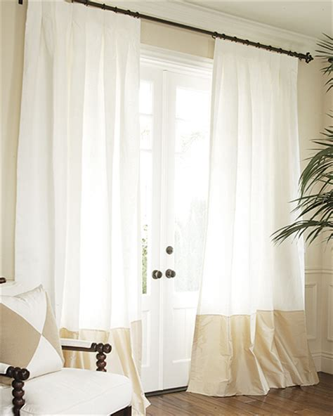drape style hand made silk bordered linen drapery and roman blinds on