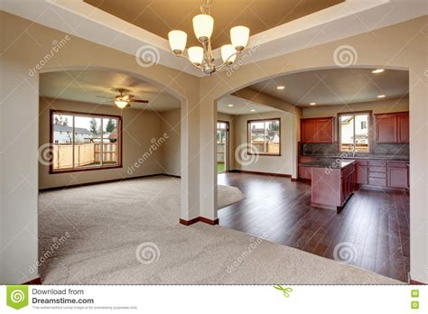 open floor plan kitchen living room and hearth room open floor plan interior with carpet and fireplace stock