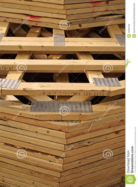 stack of wood roof trusses for new home stock image