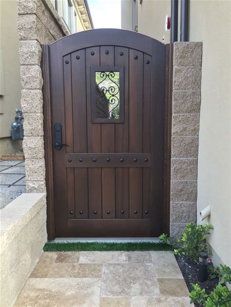 custom wood gate  garden passages tuscan style arched