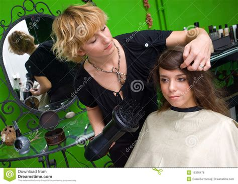 Hair Dryer Quit Working stylist with hair dryer working royalty free stock photos
