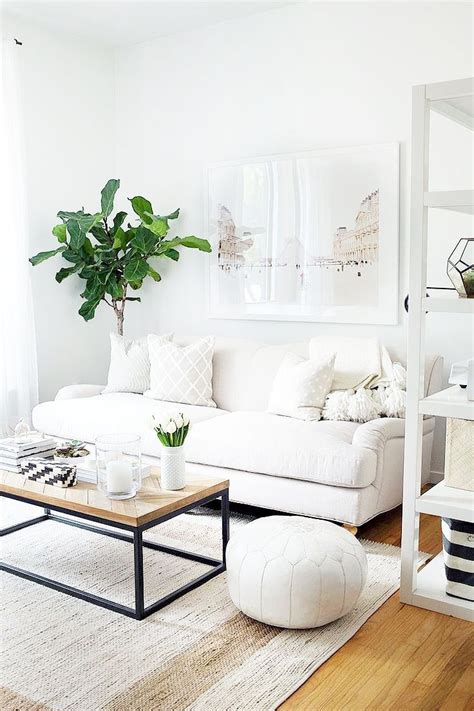 White And Beige Living Room by 9 Starter Pieces Everyone Needs To Build A Home