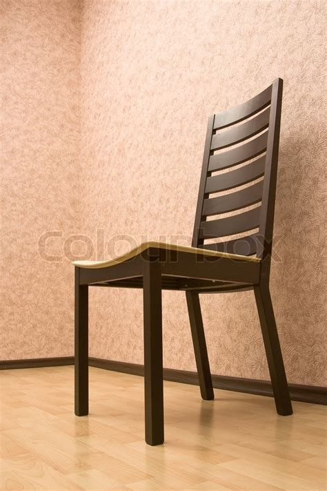 The Chair Is Against The Wall by Modern Wooden Chair Against A Wall Stock Photo Colourbox