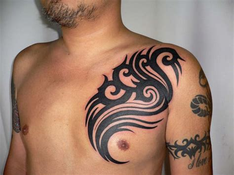 tribal tattoos arm and chest chest tattoos chest tattoos for