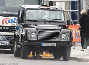 4x4 land rover defender seen displaying a yellow for hire