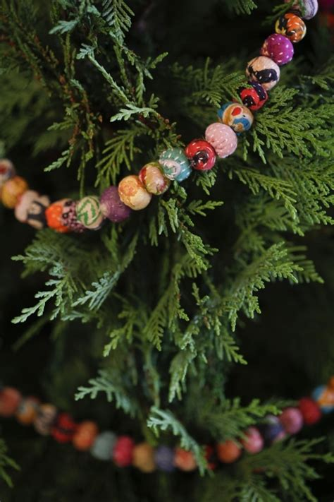 beaded garland for tree fabric pom poms sleigh bells
