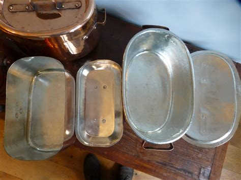 magnificent set of re tinned copper pans copper