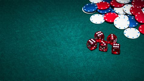 photo bright red dices  casino chips  green poker background