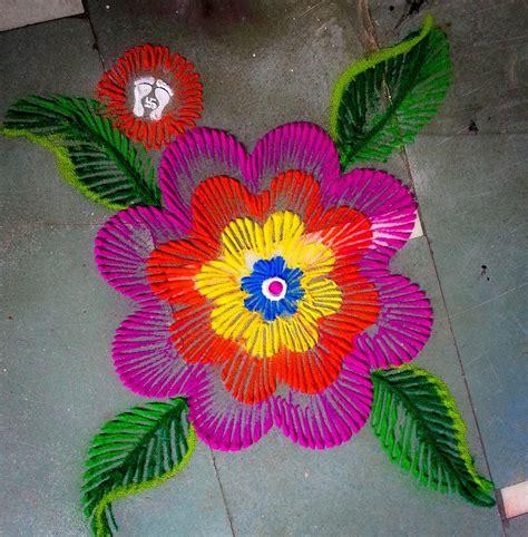 Themes For Rangoli Making | marigold flower with crepe paper rangoli designs diwali