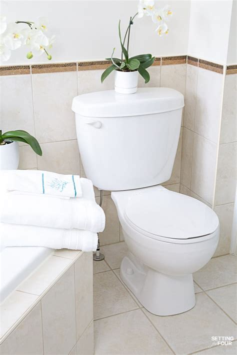 clean a bathroom how to deep clean your bathroom in 5 steps setting for four