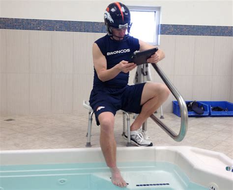 here s why peyton manning was wearing a helmet in the tub