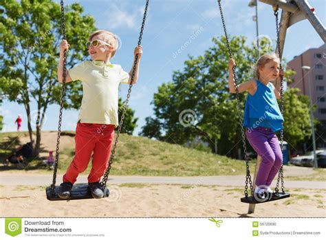 person on swing kids on playground swing stock photography cartoondealer