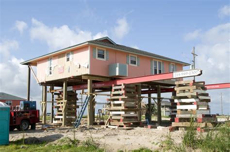 file fema 44202 home being elevated in