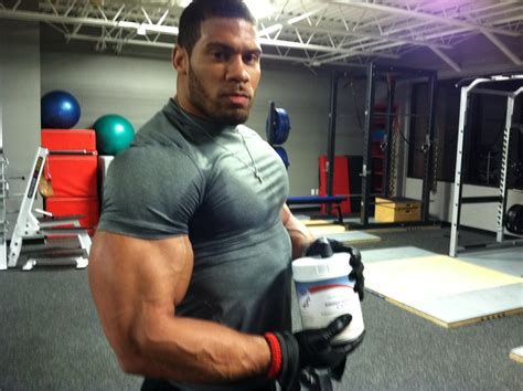 strongest football player bench press laron landry is a certified monster with cartoonishly