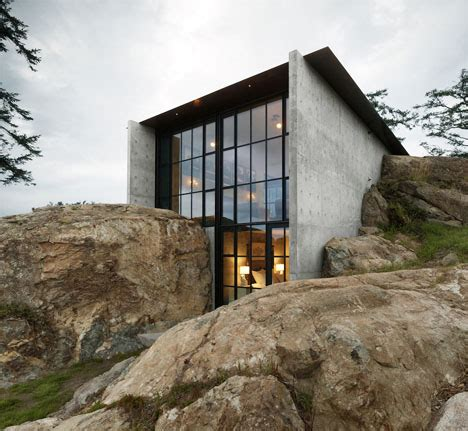 camouflaged concrete hill house blends  landscape designs ideas  dornob