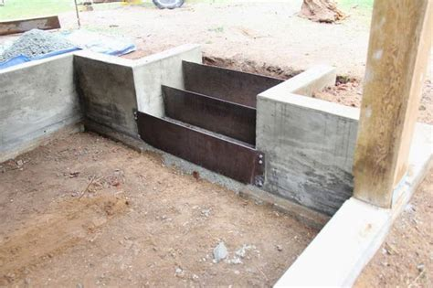 concrete retaining wall and corten steel risers stairs
