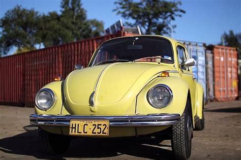 modest volkswagen beetle spanks  porsche