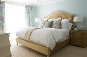 beige and blue bedroom with key nightstand