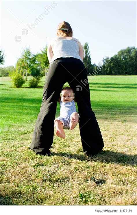 mom swinging baby mother swinging little baby image