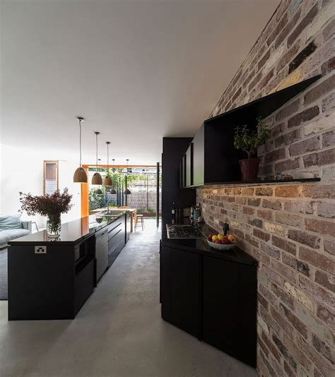 black kitchen walls budget family home in sydney uses reclaimed bricks