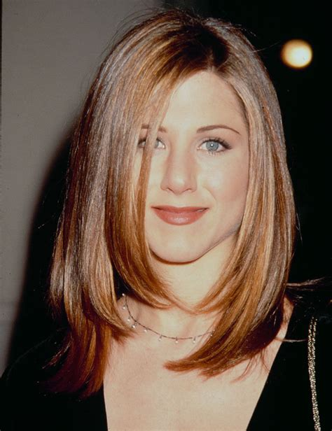 jennifer aniston steps out with new blond bangs while hair evolution jennifer aniston