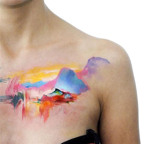 watercolor mountains on girls chest best tattoo design ideas