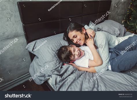 mom son bed mother son bed laughing christmas stock photo 560432122
