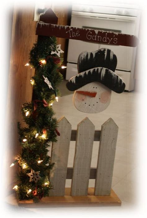 ideas for decorating iron fence posts for christmas snowman picket fences and welcome post on