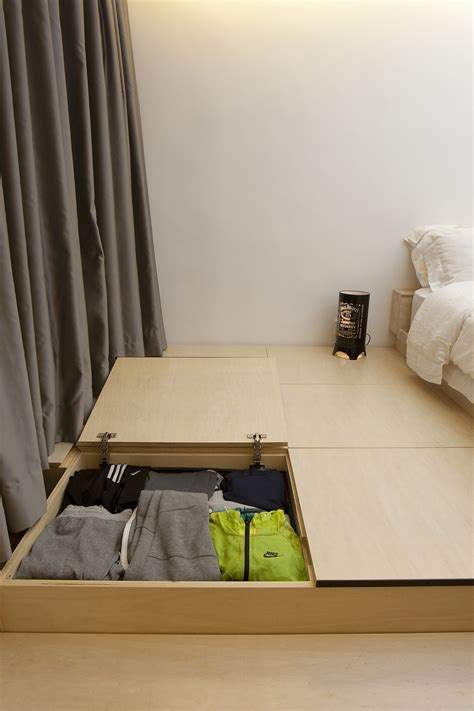 raised bedroom floor inside the shape shifting 452 square foot hong kong flat dubbed the city transformer