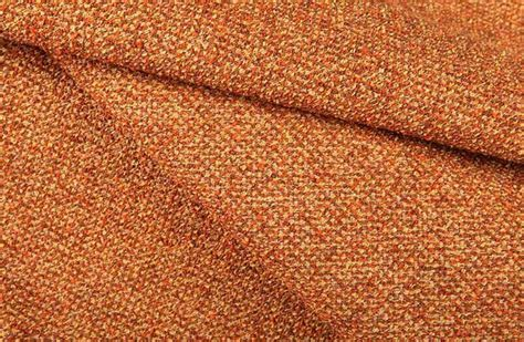 homespun textured upholstery fabric in orange rustic