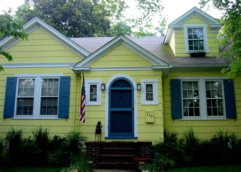 yellow house home designs ideas yellow house blue shutters