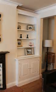 Fitted alcove cupboards built in bookcases and living room furniture