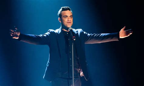 Williams Reunited With by Robbie Williams Shares After Being Reunited
