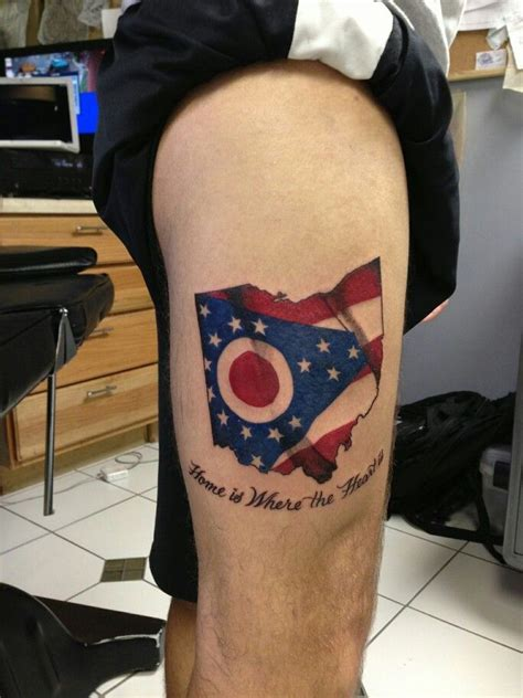 state of ohio with the state flag waiving tattoo sleeve