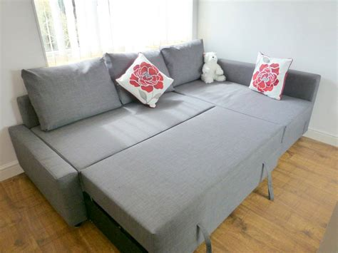 Ikea Sofa Pillows Light Gray Friheten Ikea Sofa Bed With Pillows And Floral Cushions On Hardwood Floor Decofurnish