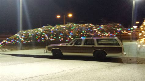 man in replica christmas vacation vehicle brings holiday