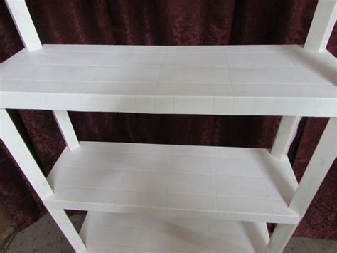 lot detail white plastic shelving unit