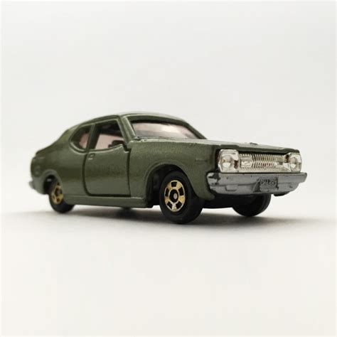Tomica Nissan Cherry F Ii 1400 Coupe Gx Y1093 nissan cherry f ii 1400 coupe gx 増えすぎたミニカーに愛を捧ぐ