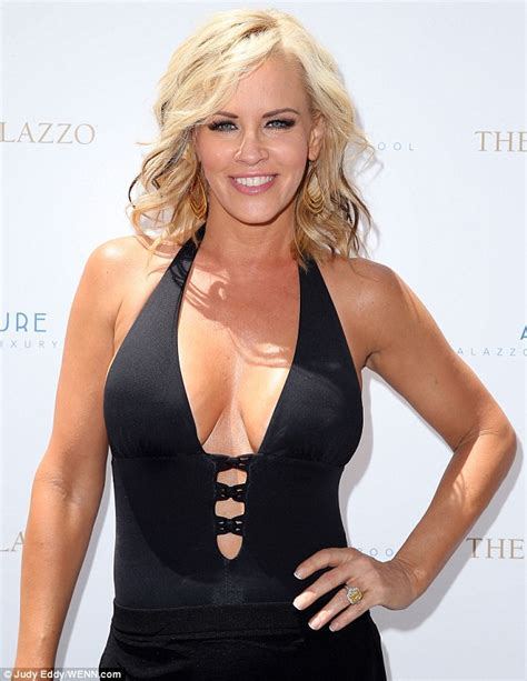 Jenny McCarthy is in great spirits as she soaks up the sun in Vegas in plunging black swimsuit