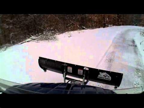 2009 kawasaki teryx plowing driveway and feeder road