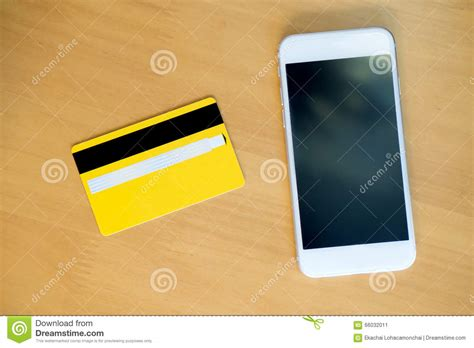 bench credit card credit card with smartphone on table stock photo image