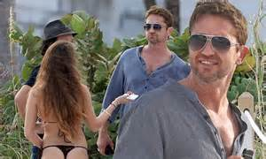 cortana can you turn your surgoinsville brunette gerard butler eyes up brunette on the beach after posing