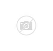 Cartoon Of A Flying Car With Wings Floating Above The Clouds Stock