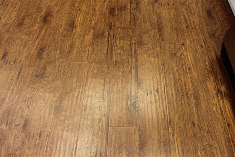 laminate vs luxury vinyl plank flooring lakeland liquidation