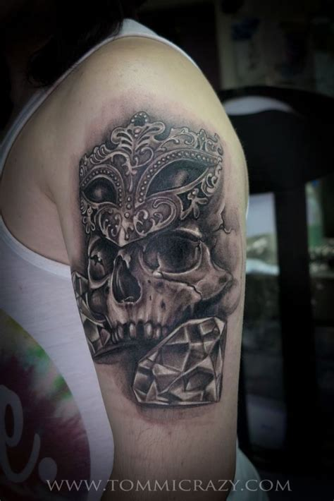 huge skull tattoo w masquerade mask amp diamonds on guy s arm