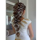 Wedding  Loose Curly Ponytail Hairstyle With Ribbon And Baby