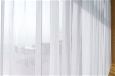 white see through curtains white curtains see through doors glass stock photo image